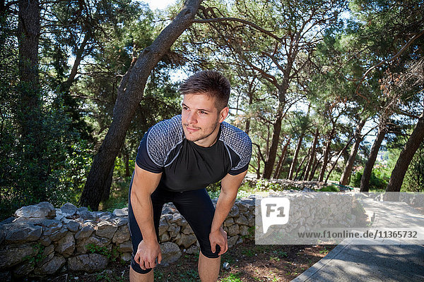 Young male runner taking a break in park  Split  Dalmatia  Croatia