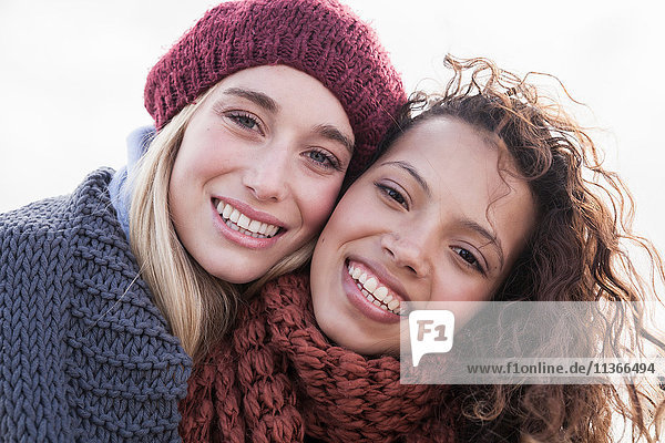 Portrait of two young female friends at beach  Western Cape  South Africa