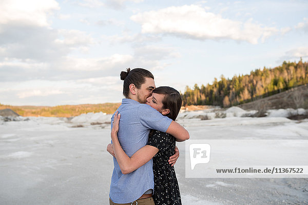 Couple hugging on snow-covered landscape  Ottawa  Ontario