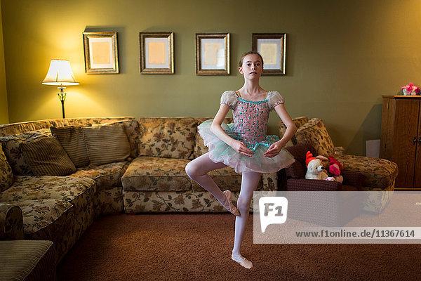 Girl in living room ballet dancing