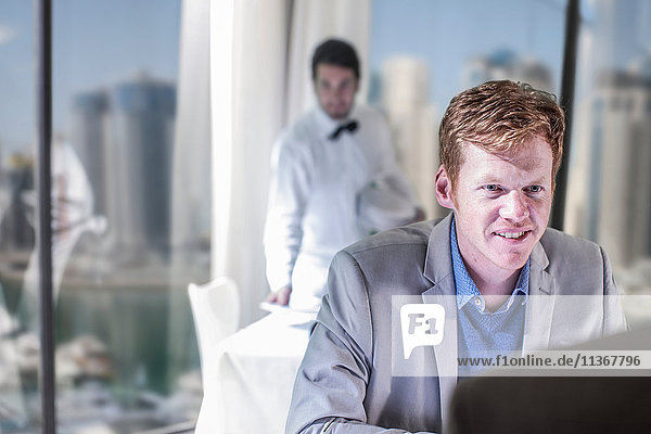 Man talking over lunch in hotel restaurant
