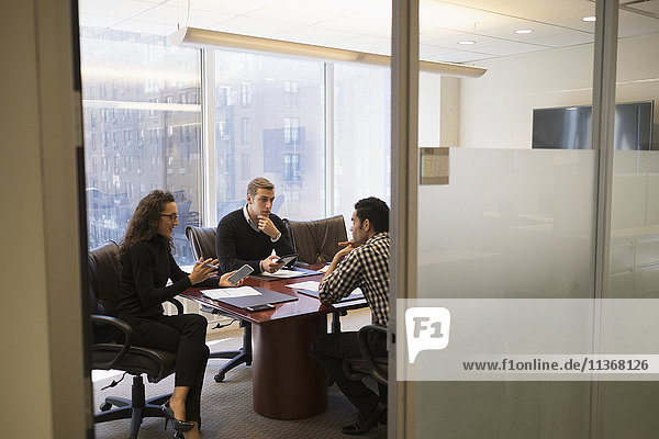 Young business people having meeting in conference room