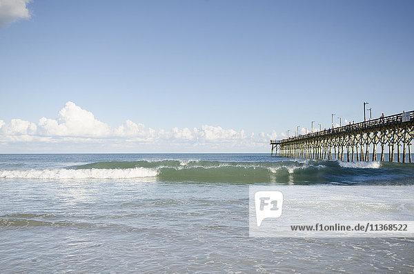 USA  North Carolina  Topsail island  Surf City  Seascape with pier