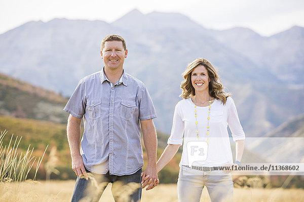 USA  Utah  Provo  Smiling couple holding hands