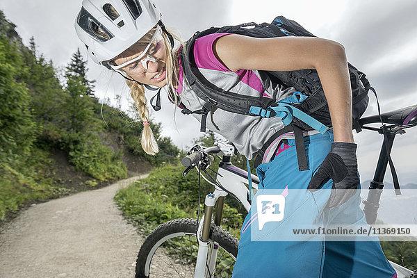 Mountainbiker with pain in bottom  Kampenwand