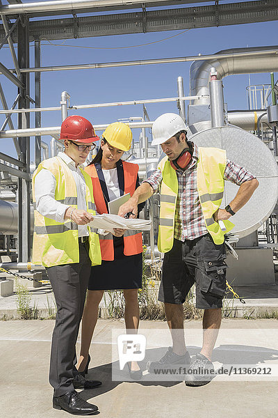 Engineer with his colleagues in meeting at geothermal power station