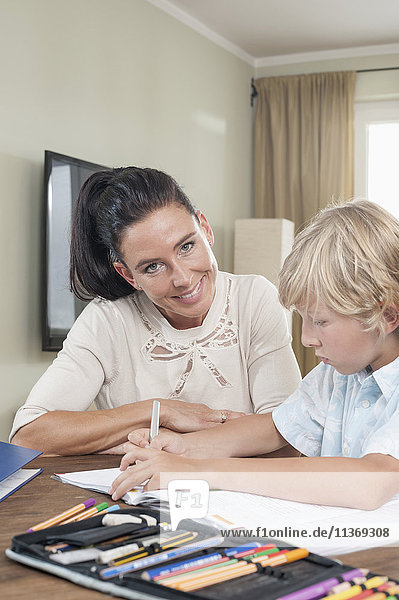 Woman helping her son with his homework