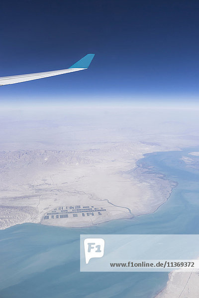 Cropped image of airplane flying above oman and red sea Iran  Oman