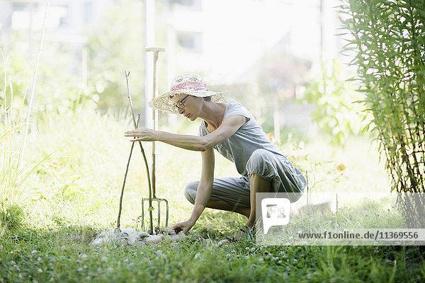 Mature woman working in urban garden