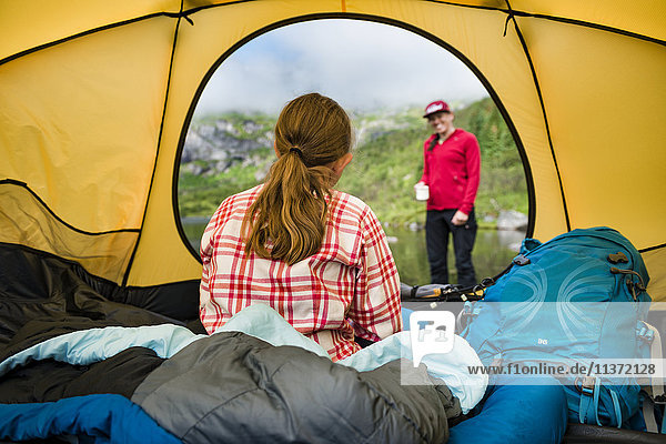 Mother with daughter camping