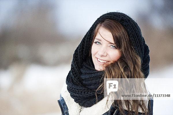 Portrait of woman wearing scarf