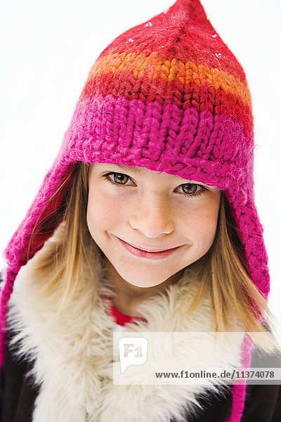 Portrait of girl wearing knitted hat