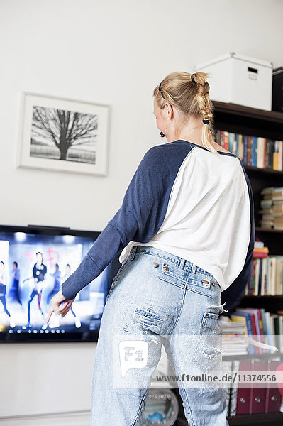 Woman playing video game