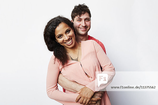 Portrait of smiling couple hugging
