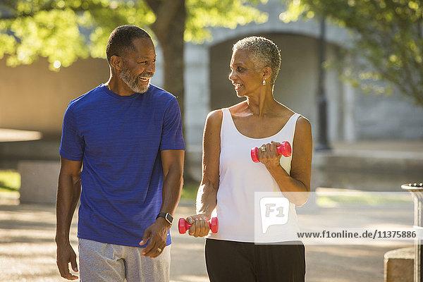 Black couple walking in park
