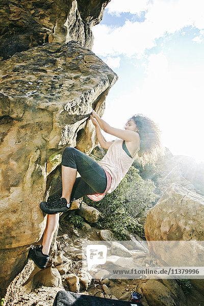 Hispanic woman rock climbing Hispanic woman rock climbing