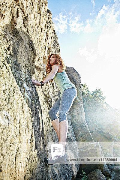 Caucasian woman rock climbing Caucasian woman rock climbing