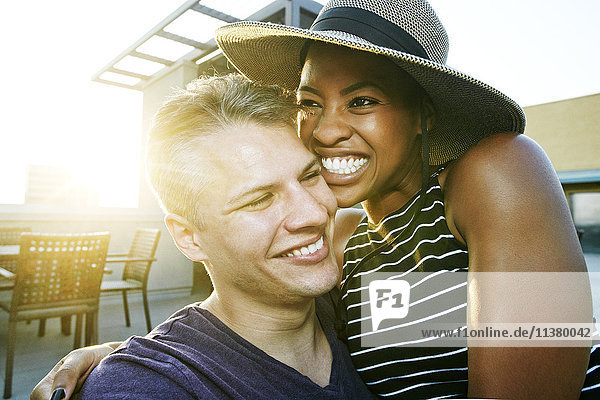Portrait of smiling couple on rooftop