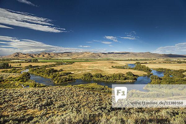 Winding river near mountain range