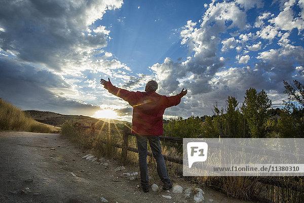 Caucasian man admiring sunset