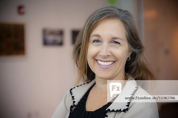 Portrait of smiling Caucasian businesswoman