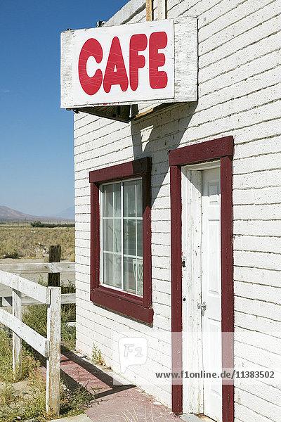Cafe sign on abandoned building