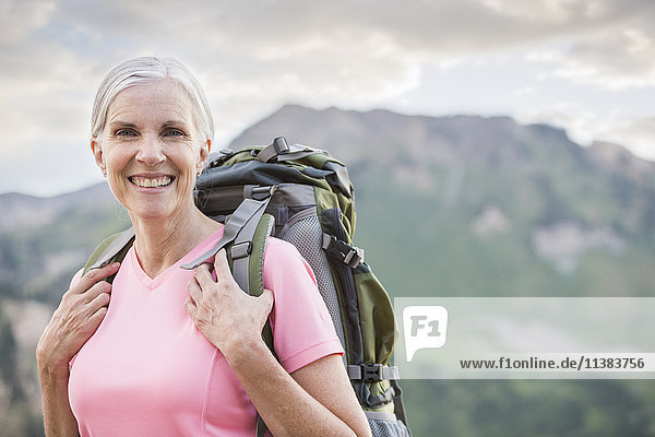 Caucasian woman hiking on mountain