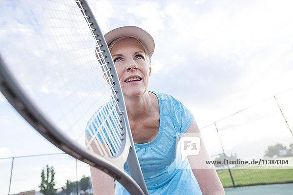 Caucasian woman holding tennis racket