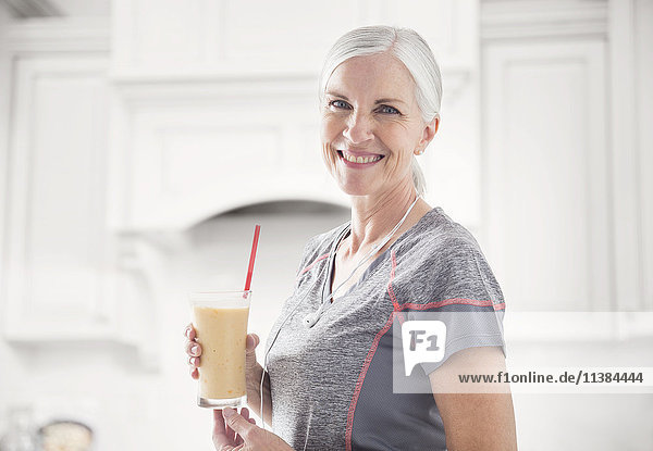Caucasian woman posing with smoothie