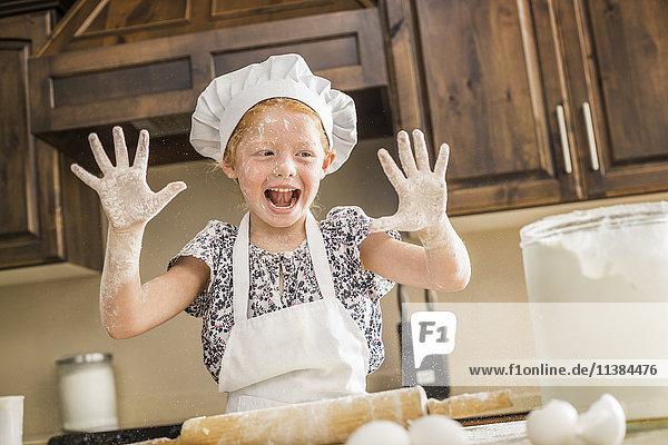 Caucasian girl covered in flour