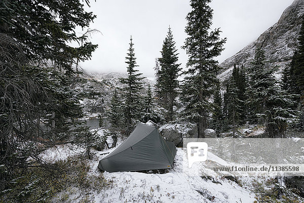 Camping tent in snowy landscape