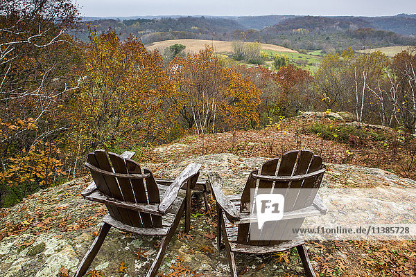 Adirondack chairs in rolling landscape