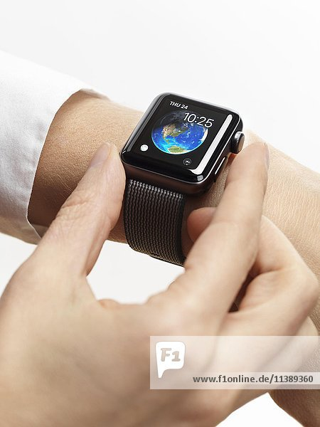 Woman hand with Apple Watch  smartwatch on her wrist