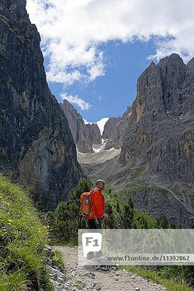 Hiker  mountain tour  track around Langkofel  Dolomites  Province of South Tyrol  Italy  Europe