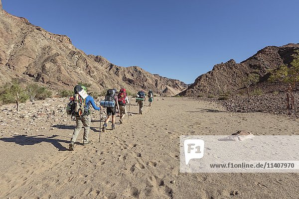 Hikers in dry riverbed  Fish River Canyon  Namibia  Africa