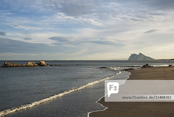 View of The Rock of Gibraltar and La Linea de la Concepcion as seen from the Mediterranean coast in the early morning light  Cadiz  Andalusia  Spain  Europe