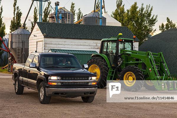 'A pick up truck and tractor on a family farm; Herschel  Saskatchewan  Canada'