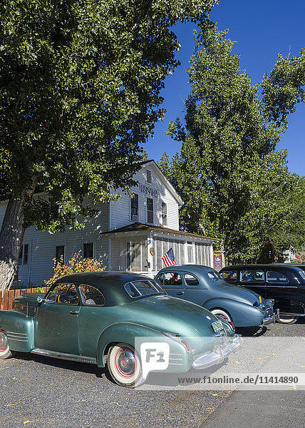 'Classic cars park in front of the Frenchglen Hotel; Frenchglen  Oregon  United States of America'