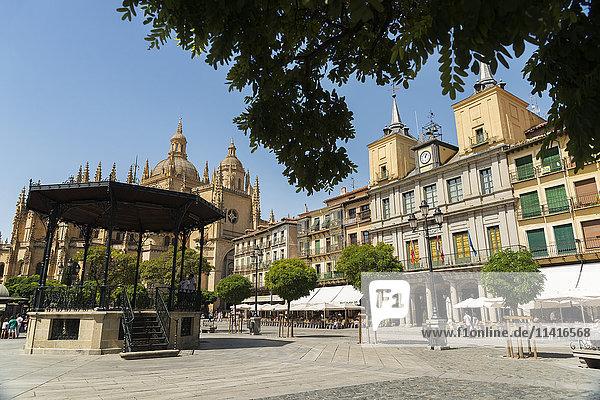 'A church and buildings in a town square; Segovia  Castilla Leon  Spain'