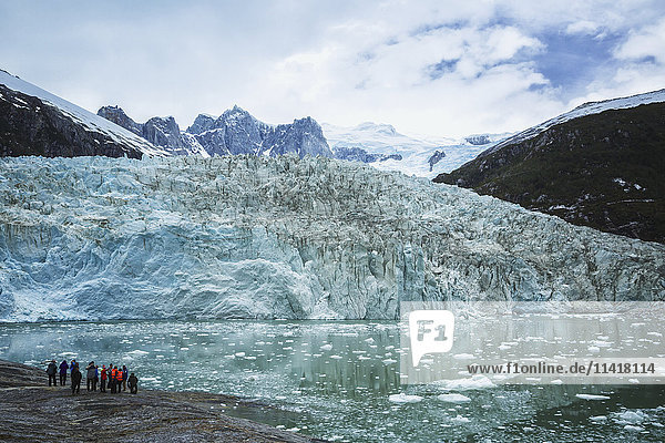 'Tourists on excursion from tour boat to view Pia Glacier in Tierra del Fuego  Chilean Patagonia; Chile'