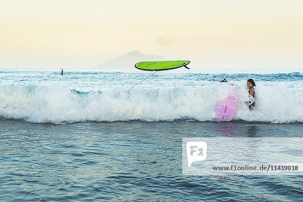 'Beginner surfers suffering from the strength of the ocean  Waiao beach  Yilan County; Taiwan  China'
