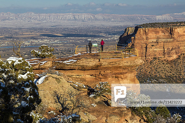 'Two female tourists enjoy the views of the Colorado National Monument; Colorado  United States of America'