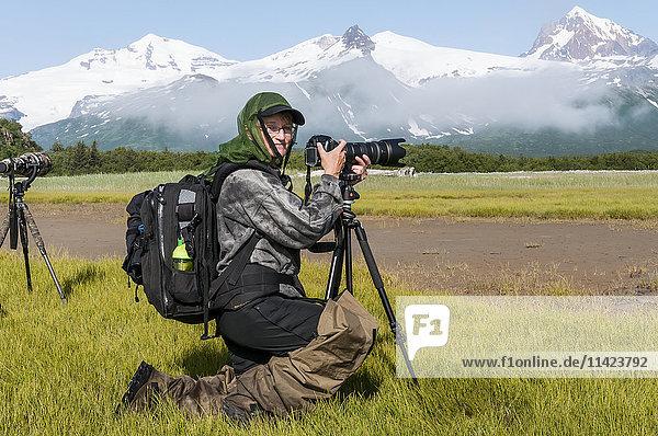 Photographer in a scenic landscape at Hallo Bay  Katmai National Park  Southwest Alaska  USA