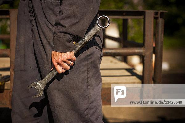 'A farmer's hand holding a large wrench; Herschel  Saskatchewan  Canada'