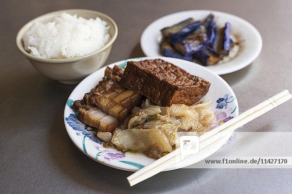 'Local food in Waiao  Yilan Country  cabbage  eggplant  tofu  pork and rice; Taiwan  China'