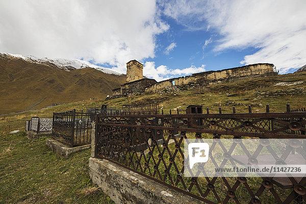 'Cemetery of the Lamaria church  set against the backdrop of the Greater Caucasus Range; Ushguli  Samegrelo-Zemo Svaneti  Georgia'