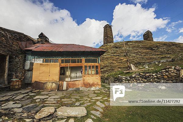 'House and Svan stone towers in Chazhashi village; Ushguli  Samegrelo-Zemo Svaneti  Georgia'