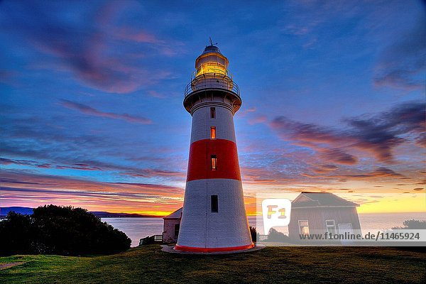 Low Head Lighthouse at sunset. It guides shipping into the mouth of the Tamar River and was built in 1833. Near George Town  Tasmania  Australia. (Photo by: Auscape/UIG)