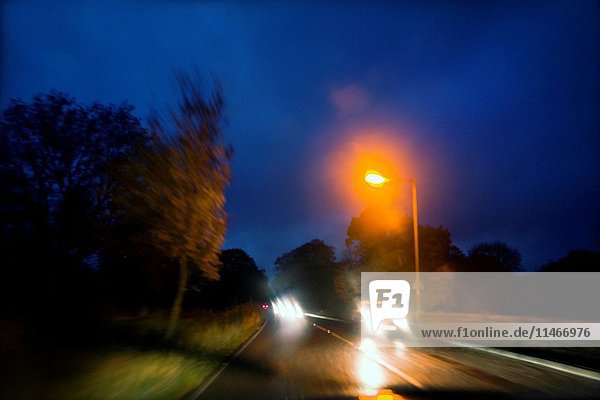 Traffic on the road from Skipton to Grassington in the evening  headlights  North Yorkshire  England