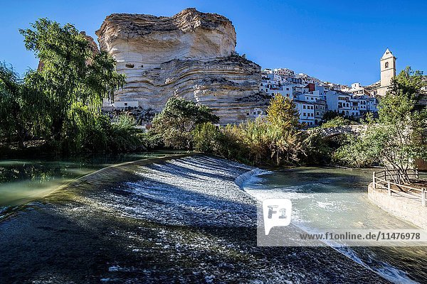 Recreation area on the River Jucar  beautiful mountain views limestone next to the city  take in Alcala of the Jucar  Albacete province  Spain.